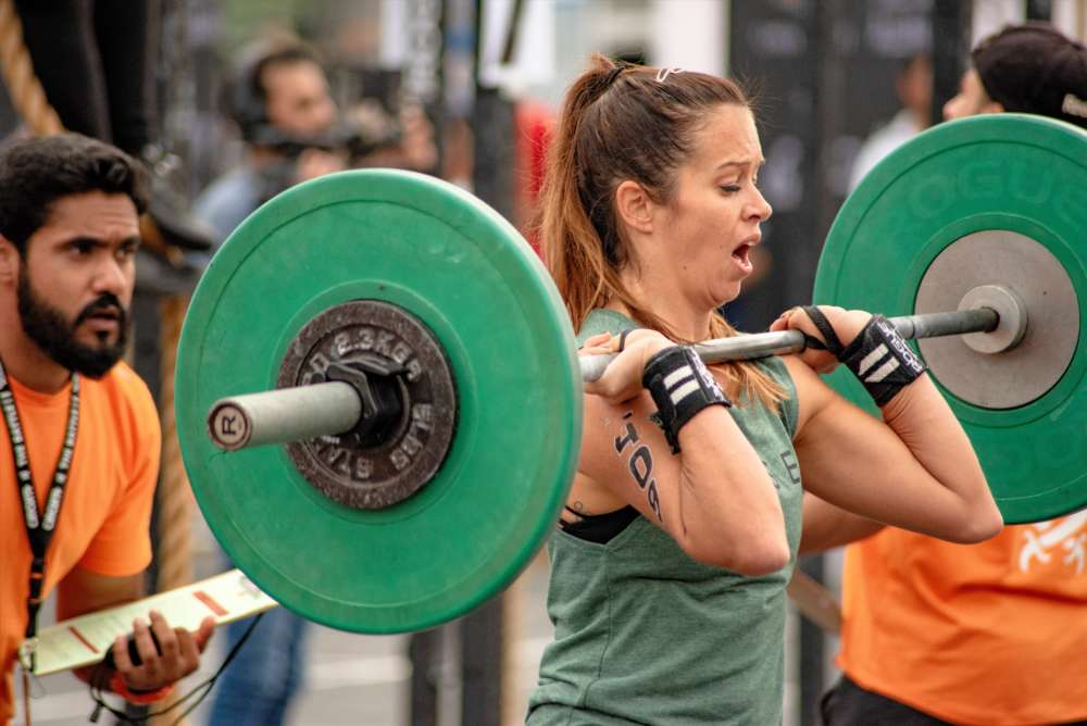 adults-athlete-barbell-1566414