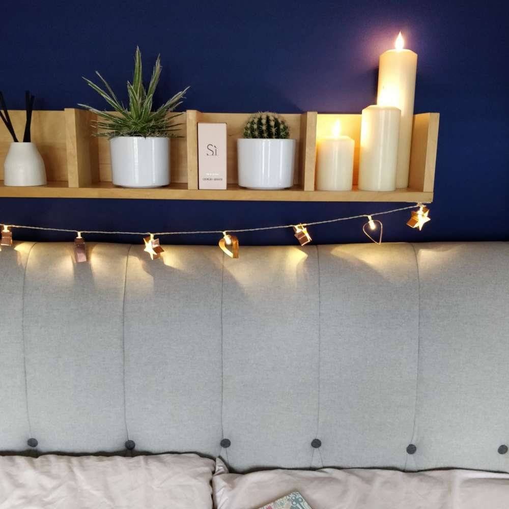 Faux-pillar-candles-from-Candled-on-a-bedroom-shelf-1-1440×1440