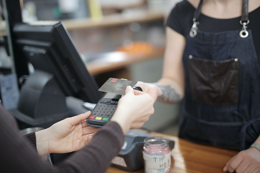 person-holding-credit-card-3907161